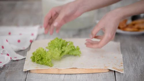Chef Put on Green Leaves Vegetables on Pita Bread