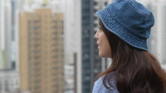 Thumbnail for Woman look around the view of the city