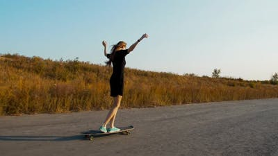 Walking on a Longboard While Moving, Youth Sports, Evening
