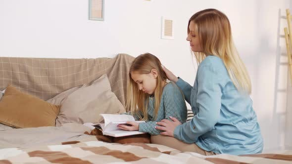 Thumbnail for Mother and Daughter Reading Book in Bedroom