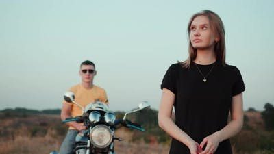 Portrait of a Young Woman Behind Carrying a Guy on a Motorcycle