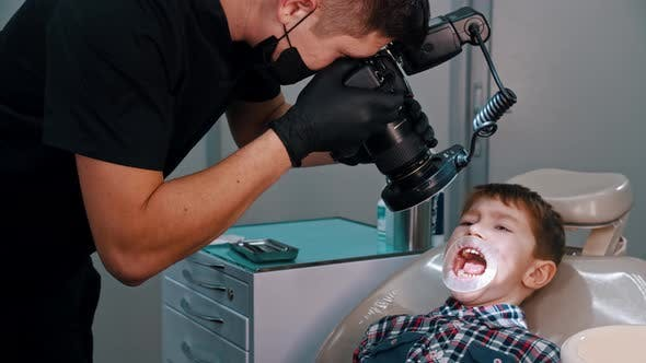 Thumbnail for A Little Boy Having a Treatment in the Dentistry - Taking Photos of the Boy's Oral Cavity