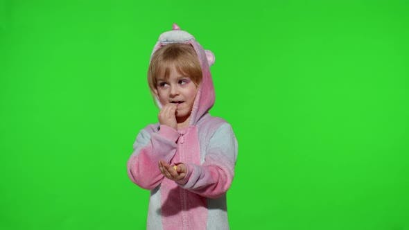 Thumbnail for Little Child Smiling Enjoying Eating Sweets Candies Dessert in Unicorn Costume on Chroma Key
