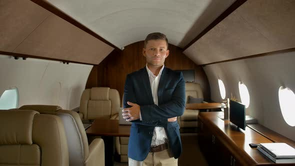 Thumbnail for Confident Businessman with Crossed Arms Inside of Business Jet