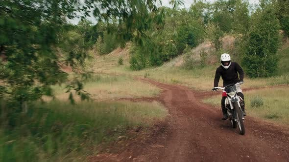 Motorcyclists Riding Off-Road in Forest