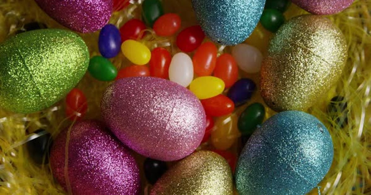 Rotating shot of Easter decorations and candy in colorful Easter grass