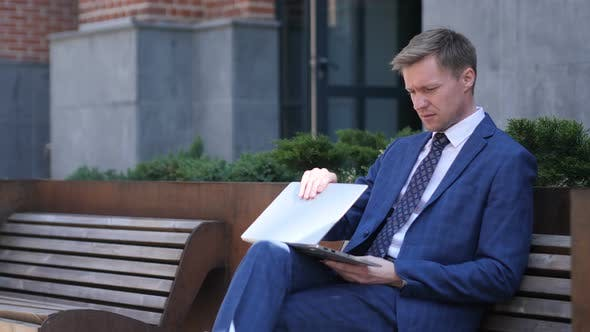 Thumbnail for Businessman Coming and Sitting on Bench and working on Laptop