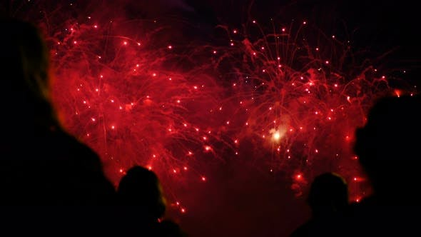 Thumbnail for Silhouettes of a Crowd of People on a Background of Colorful Fireworks. Public Watching