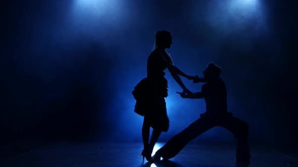 Thumbnail for Silhouette of Pair Dancers Performing Rumba Dance in Smoky Studio