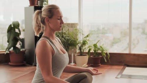 Woman Meditating Alone