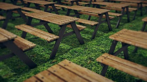 A Lot Of Wooden Picnic Table Isolated On Green Grass 4k