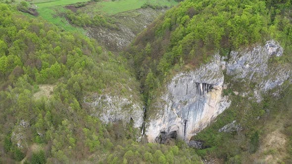 Thumbnail for Flying Above a Waterfall and Big Cave Entrance, Romania