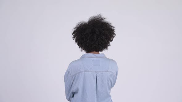 Cover Image for Rear View of Young African Woman Pointing Finger