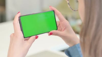 Woman Holding Smartphone with Green Screen