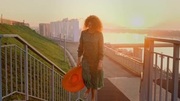 Thumbnail for Portrait of Woman Pretty Caucasian Woman with Long Hair Smiling in the City at Sunrise.