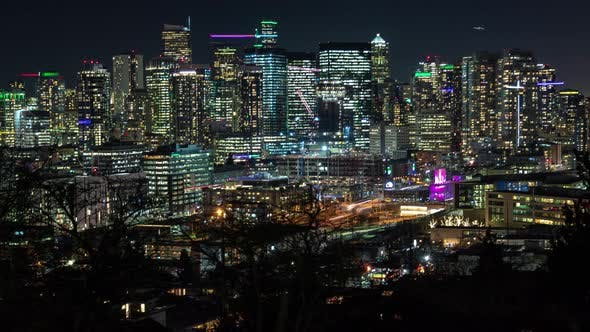 Cover Image for Bright City Skyline Building Lights Timelapse Zoom Out Night Background
