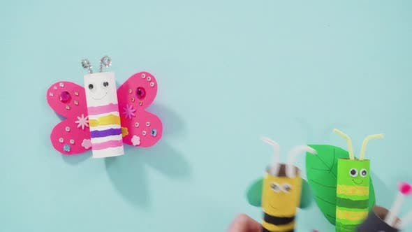 Thumbnail for Papercraft project. Colorful bugs made out of empty toilet rolls.