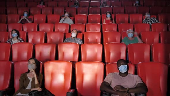 Diverse People in Movie Theater During Pandemic