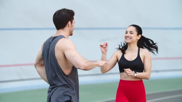 Thumbnail for Couple Training on Running Track. Fit Instructor Training Girl at Stadium