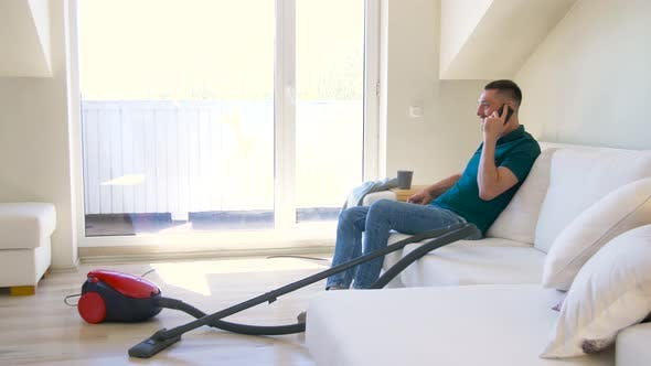 Thumbnail for Man Calling on Smartphone After Cleaning Home 30