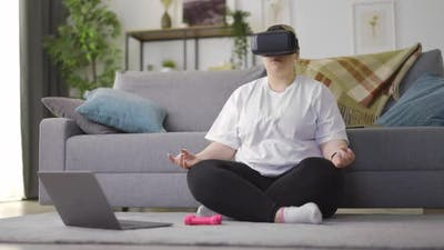 Woman Meditating in VR Glasses