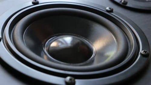 Bass speaker membrane vibration close-up 4K 2160p 30fps UltraHD footage - Playing low frequencies on