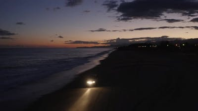 Jeep on the Beach in the Night