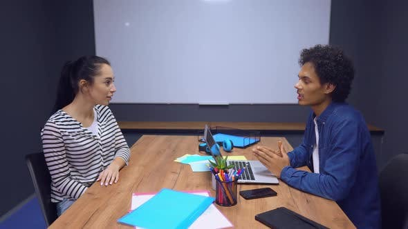 Thumbnail for Man Interviewing Young Lady In Office