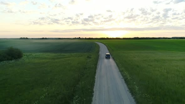 Thumbnail for Jeep Car Driving On Gravel Road Early In The Morning