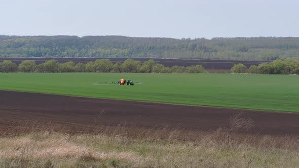 Thumbnail for Sowing, Processing of Fields. Pest Control. Trailer Sprayer in Operation.