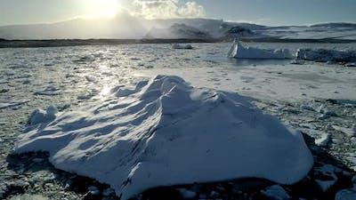 Flying Above Floating Icebergs