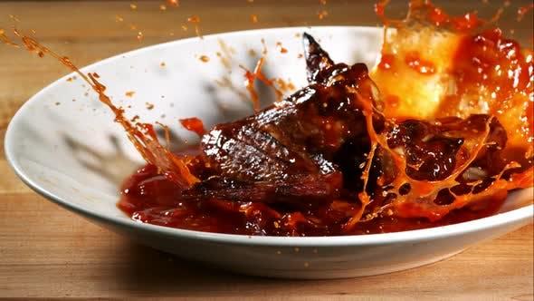 BBQ Chicken splashing in ultra slow motion