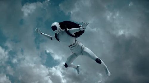 A Autonomus Cyborg Robot Skydiver Is Flying Above White Clouds Hd