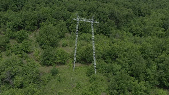 Thumbnail for Electricity transmission tower in the forest 4K aerial video