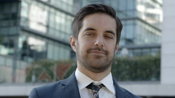 Thumbnail for Handsome Young Businessman Smiling at Camera