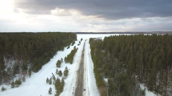 Car On A Winter Road At Stormy Weather From Above