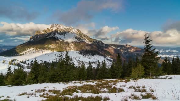 Thumbnail for Colorful Sunny Winter Morning in Snowy Mountain with Clouds Flying over Peak