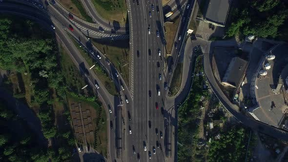 Thumbnail for Drone View Car Driving on Freeway Overpass
