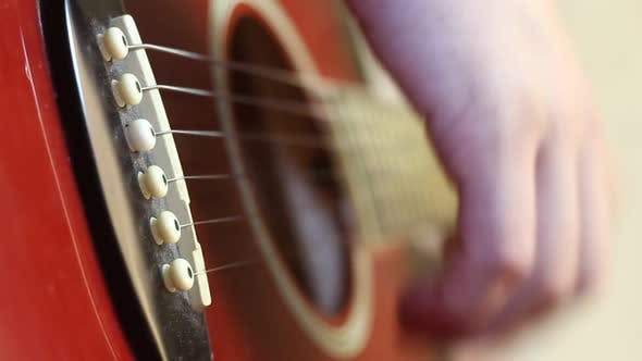 Thumbnail for Man Playing An Acoustic Guitar