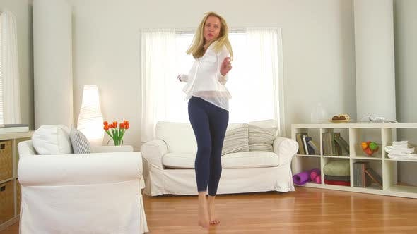 Thumbnail for Mature woman dancing in living room