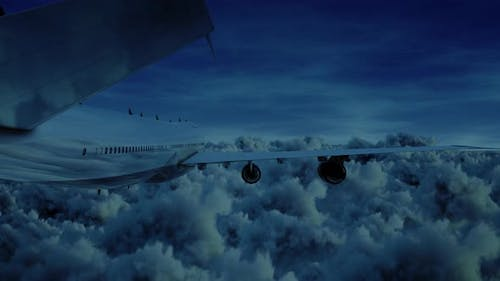 Airplane Jumbo Jet Fyling Over Storm Clouds At Night Moonlight Seamless Loop