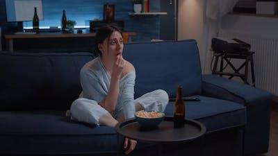 Sensitive Woman Watching Drama Movie on Tv Crying Sitting on Sofa