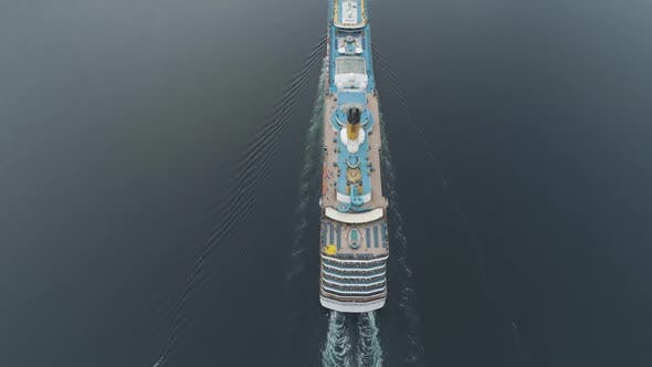Cover Image for Large Luxury Cruise Ship Is Going in Fjord of Norway. Aerial Vertical View