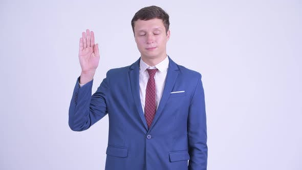 Thumbnail for Happy Young Handsome Businessman Waving Hand