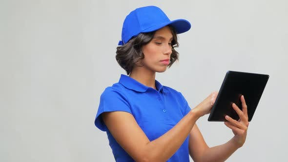 Delivery Girl in Blue Uniform with Tablet Computer