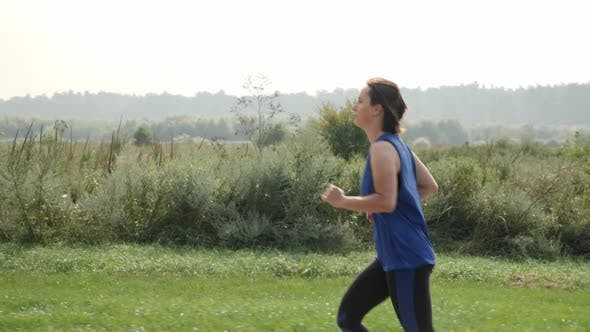 Athletic running woman in the morning