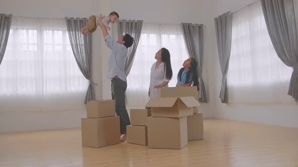 Happy Asian Family In A New House