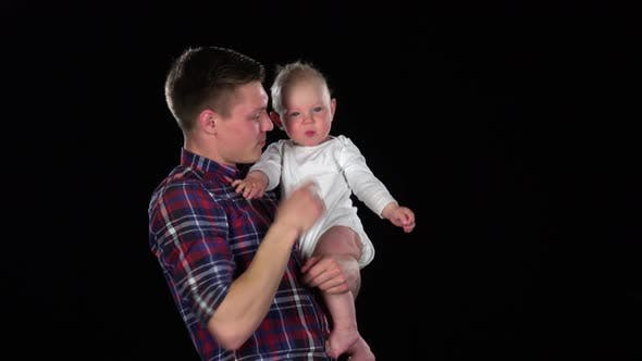Father and Baby Girl Playing Together