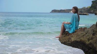 Girl Sitting on a Rocks