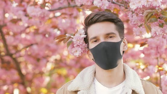 Student wearing black protective coronavirus medical mask Concept of virus protection, stop pandemic